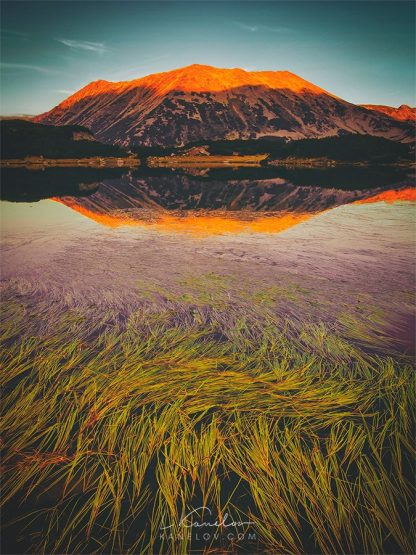 Mountain lake at sunset landscape