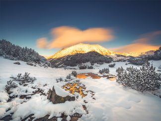 Colorful sunset over a snowy mountain