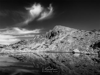 Black and white mountain lake reflection