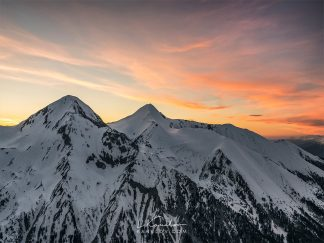 Sunset over snowy mountain peaks landscapes