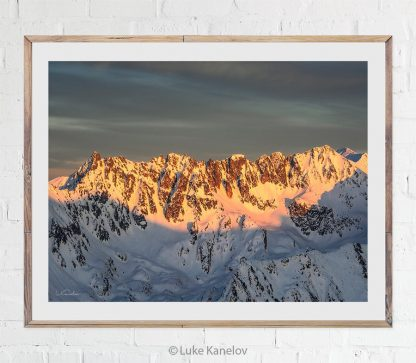 Snowy mountain peaks at sunset landscape