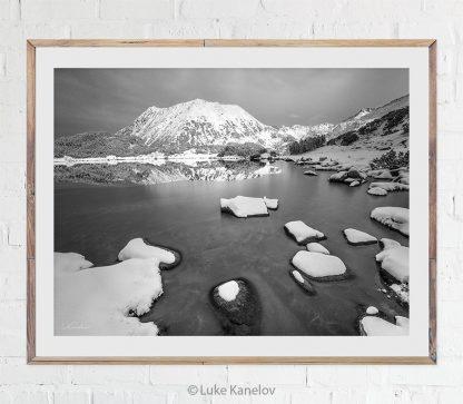 Frozen mountain lake with snow