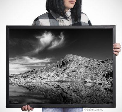Black and white mountain lake reflection
