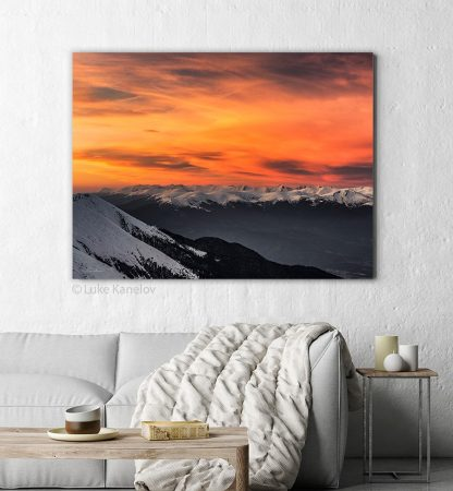 Fire sky over snowy mountains